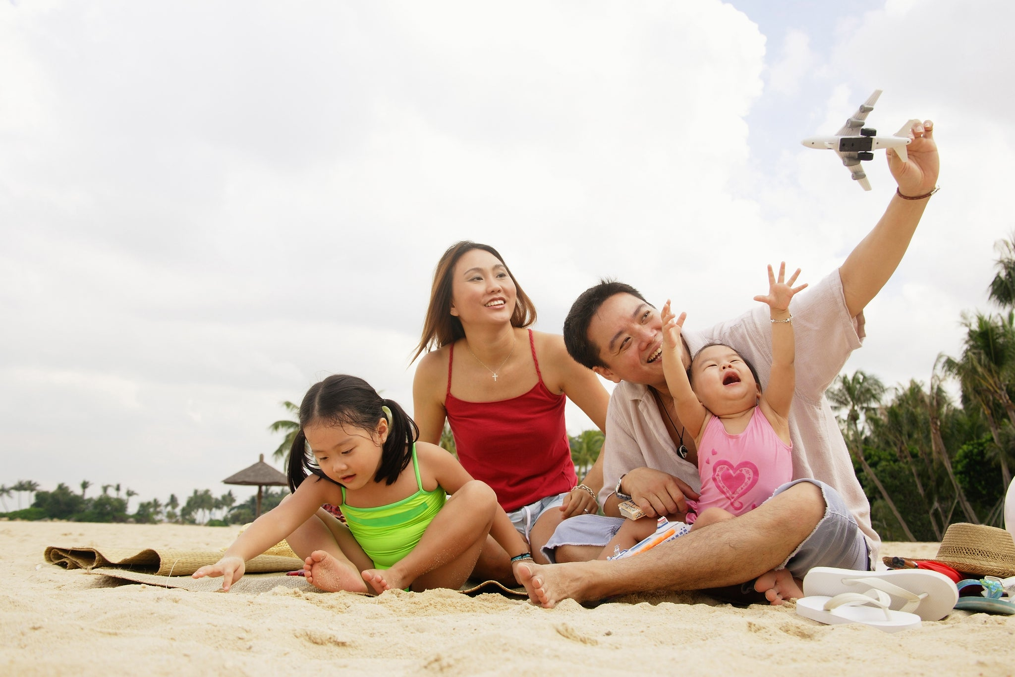 Family On The Beach In Singapore
