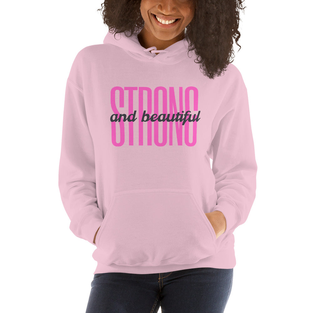 International women wearing a pink strong and beautiful hoodie by Kreamy Couture