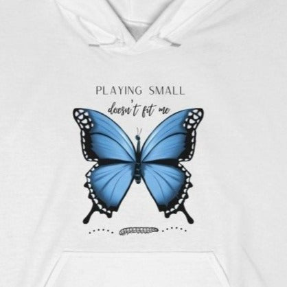 A white hoodie with a butterfly design and quote Playing small doesn't fit me