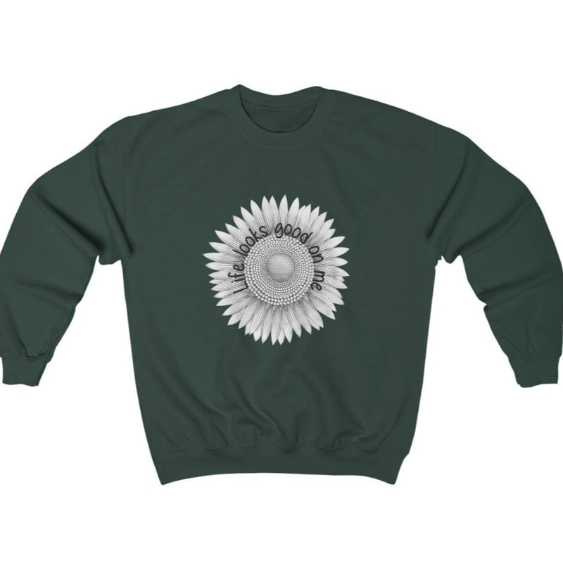 A dark green  crewneck sweatshirt with a sunflower deign and quote Life looks good on me