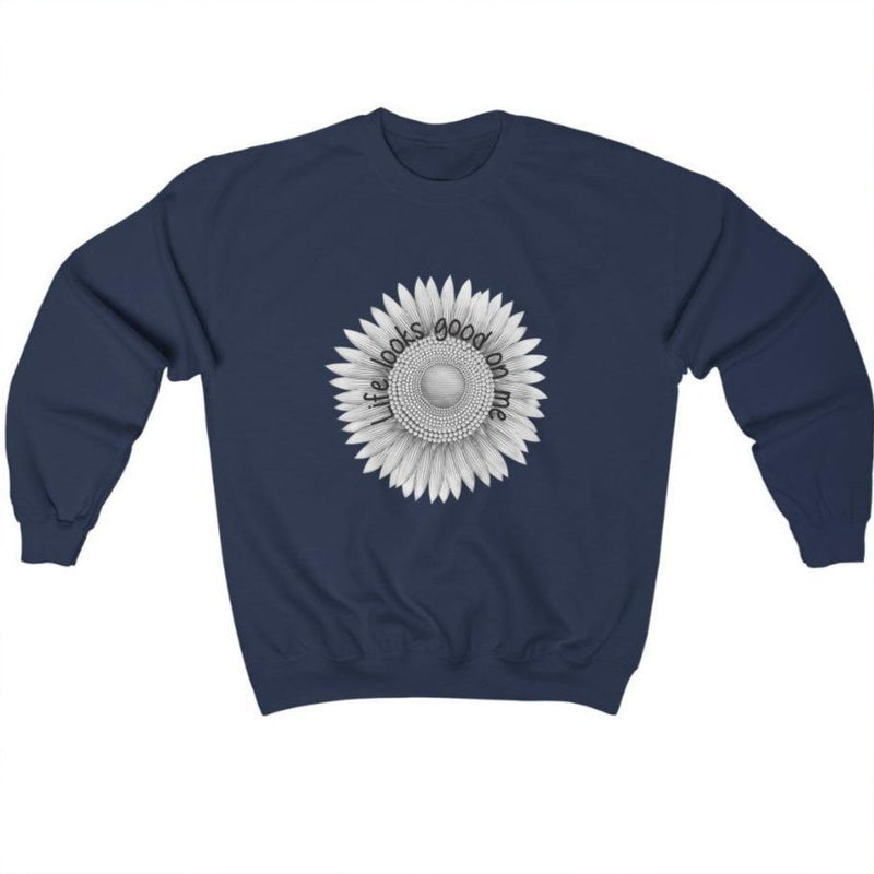 A navy crewneck sweatshirt with a sunflower deign and quote Life looks good on me