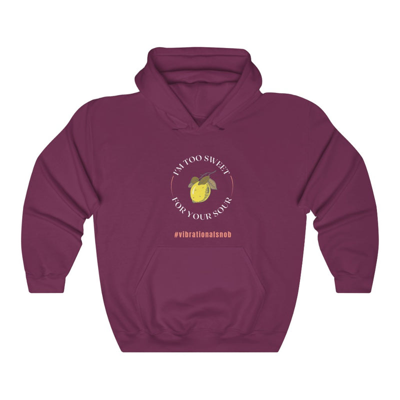 A maroon hoodie with a design Im too sweet for your sour , #vibrationla snob, and lemon.