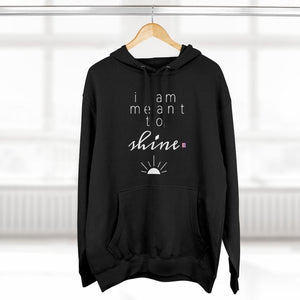 A black hoodie with a quote I am meant to shine