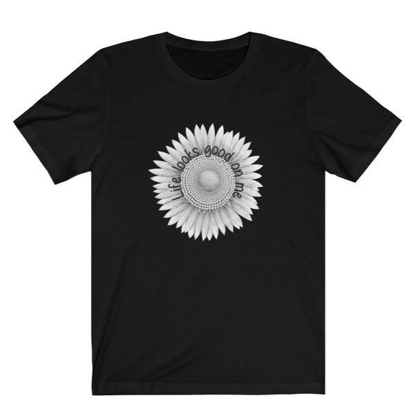 A black crewneck short sleeve tee with a sunflower design and quote Life looks good on me.