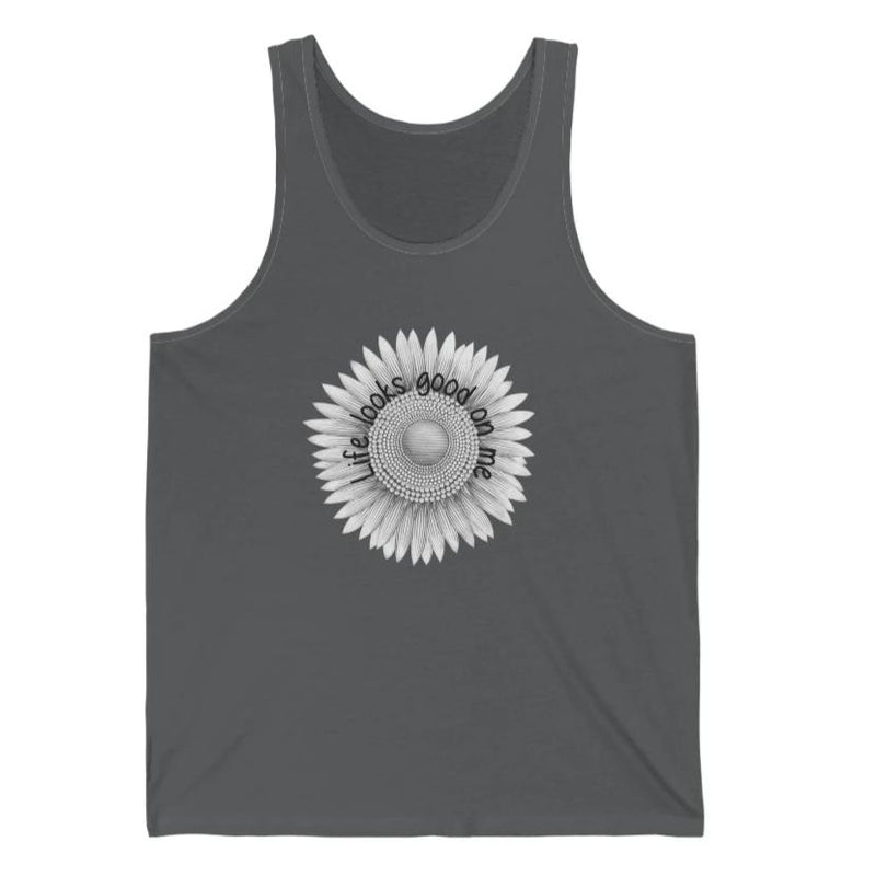 A dark grey tank top with a sunflower design and quote Life looks good on me