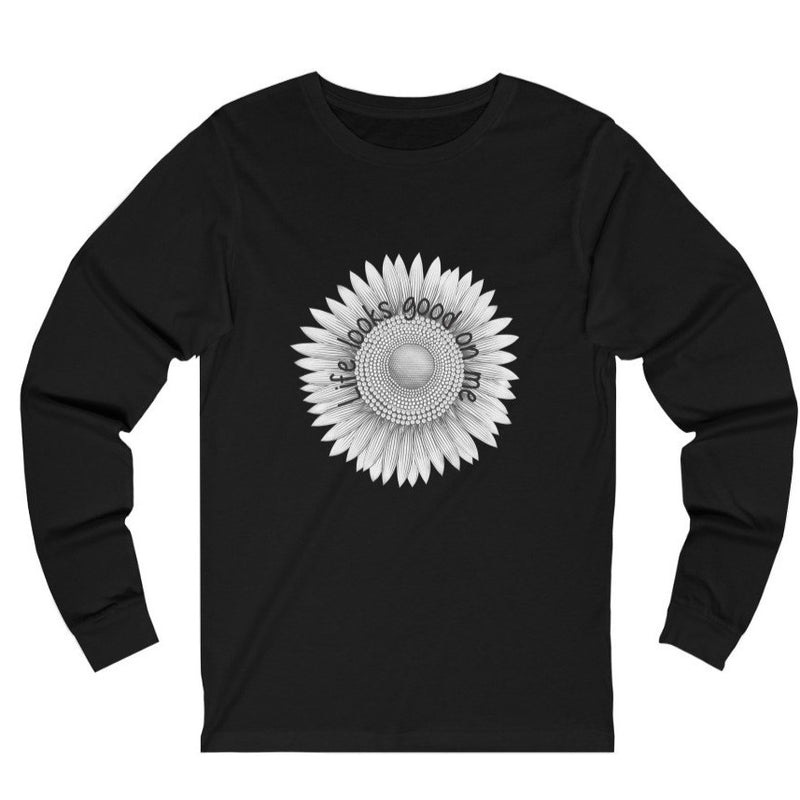 A black long sleeve crewneck tee with a sunflower design and quote Life looks good on me