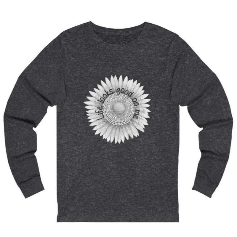 A dark grey long sleeve crewneck tee with a sunflower design and quote Life looks good on me