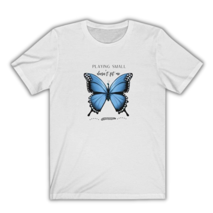 A crewneck long t-shirt in white  with a butterfly design and quote Playing small doesn't fit me