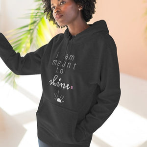 Woman wearing a black premium hoodie with a quote I am meant to shine