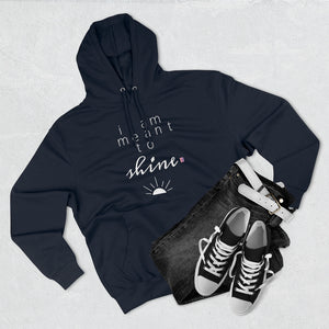 Outfit set with black jeans, black shoes, and navy hoodie with a quote I am meant shine