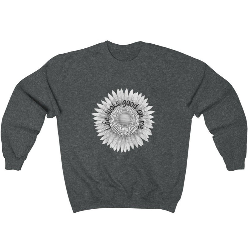 A grey crewneck sweatshirt with a sunflower deign and quote Life looks good on me