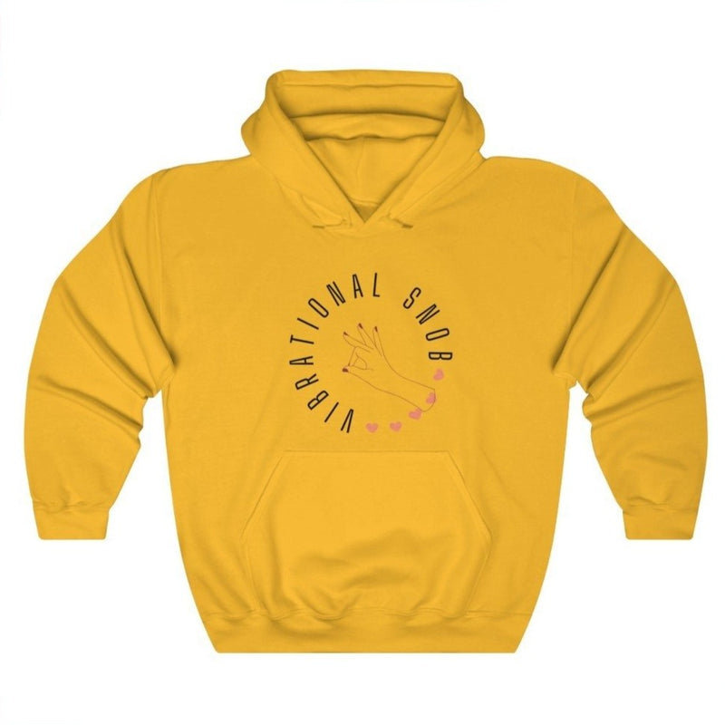 A gold hoodie with a quote Vibrational Snob