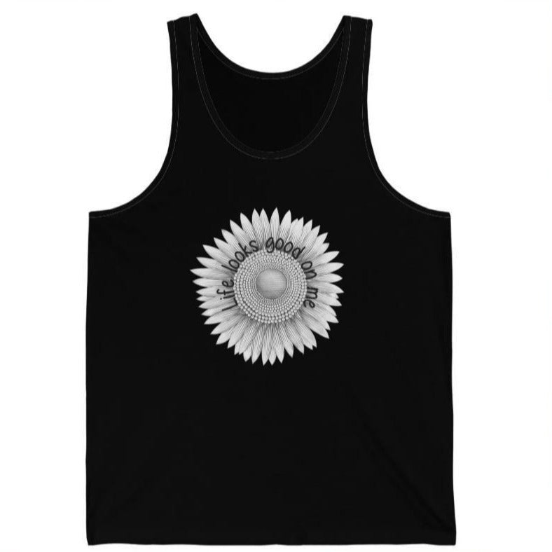 A black tank top with a sunflower design and quote Life looks good on me