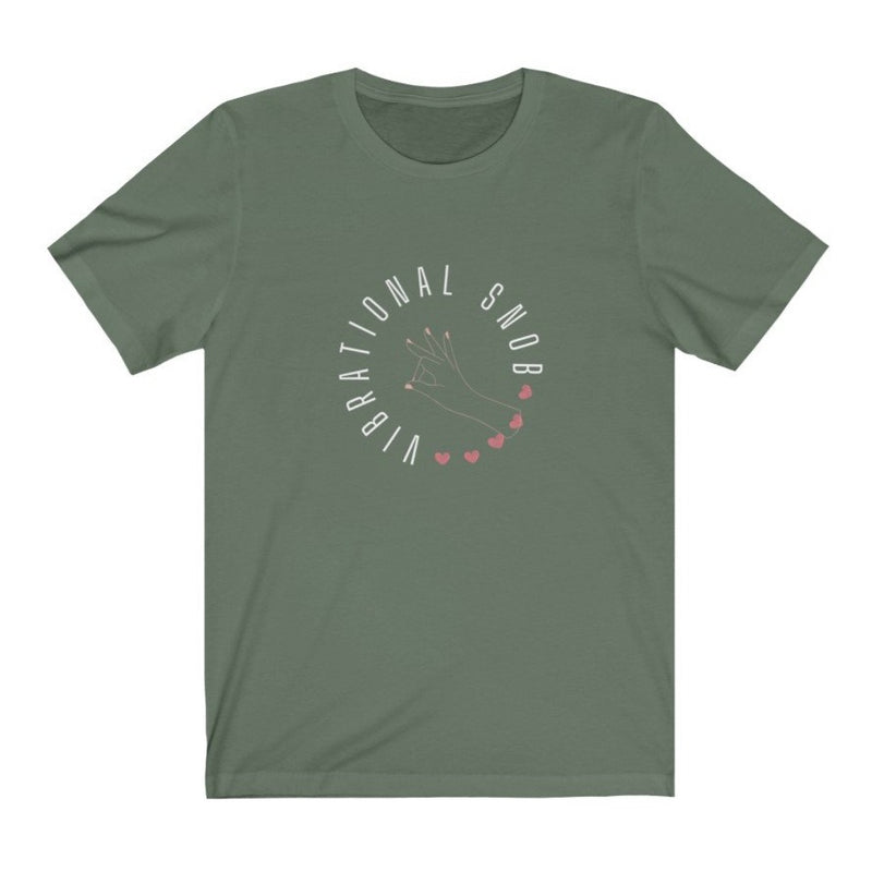 A light green crew neck t-shirt with a quote Vibrational Snob
