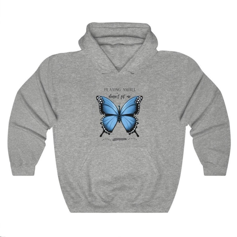 A grey hoodie with a butterfly design and quote Playing small doesn't fit me