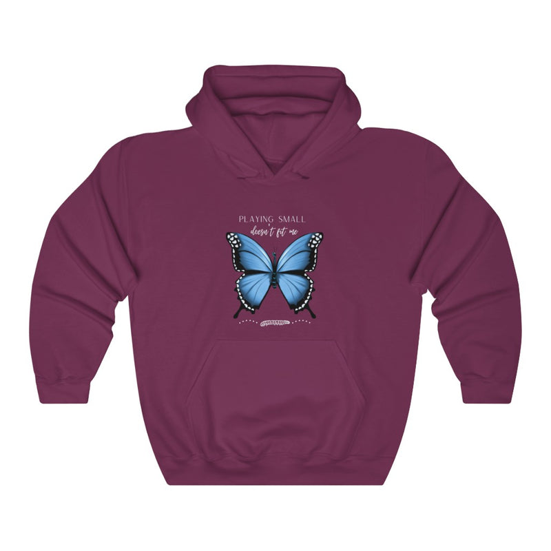 A maroon hoodie with a butterfly design and quote Playing small doesn't fit me