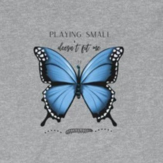 A grey  crewneck long sleeve tee with a butterfly design and quote Playing small doesn't fit me