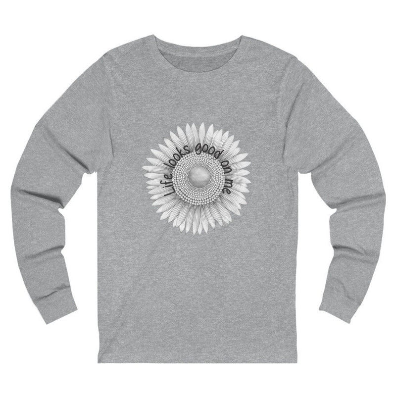 A light grey long sleeve crewneck tee with a sunflower design and quote Life looks good on me