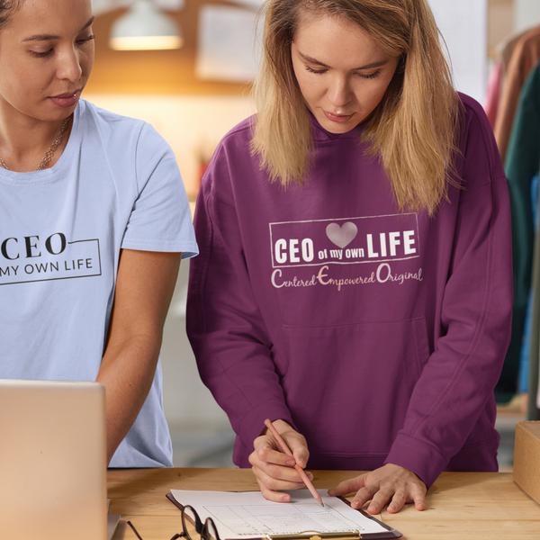 Women working wearing a crewneck t-shirt and burgundy hoodie with a quote CEO of my life