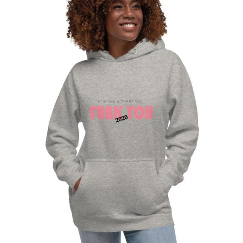 A woman wearing a grey hoodie with a quote FUNK YOU 2020