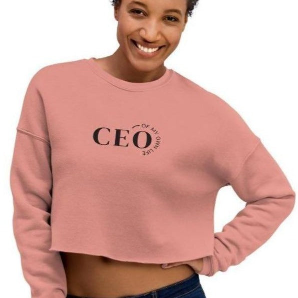 Woman wearing a Pink crop top sweatshirt with a quote CEO of My Own Life
