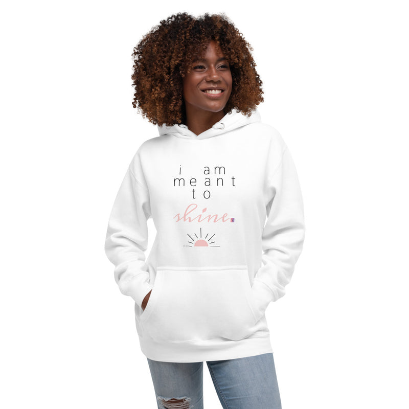 A smiling woman wearing a white hoodie with a quote I am meant to shine