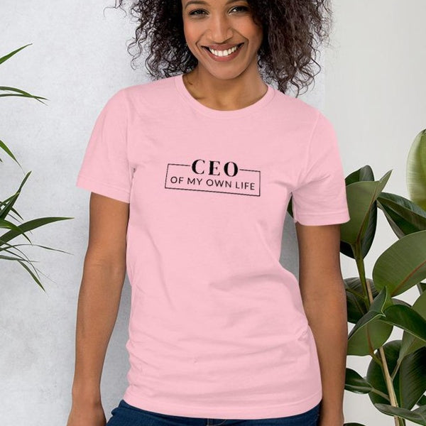 A smiling woman wearing a pink t-shirt with a quote CEO of my own life