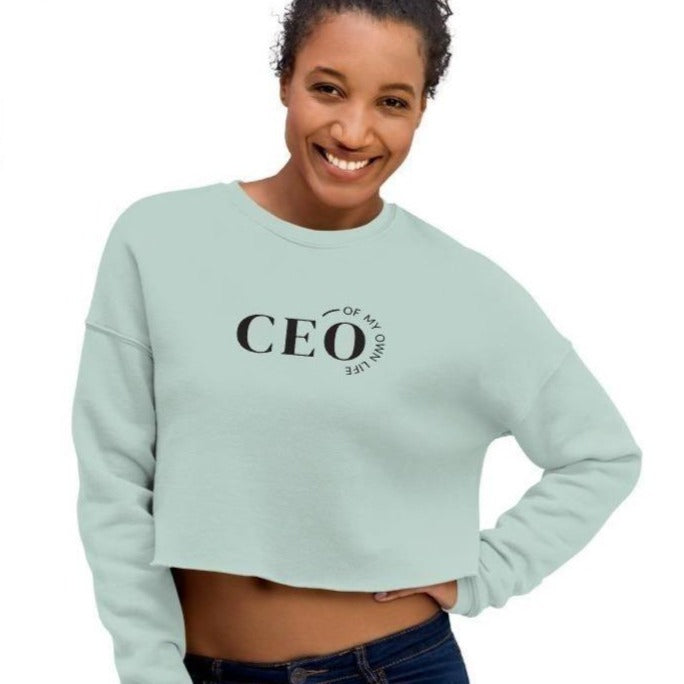 Woman wearing a mint crop top sweatshirt with a quote CEO of My Own Life