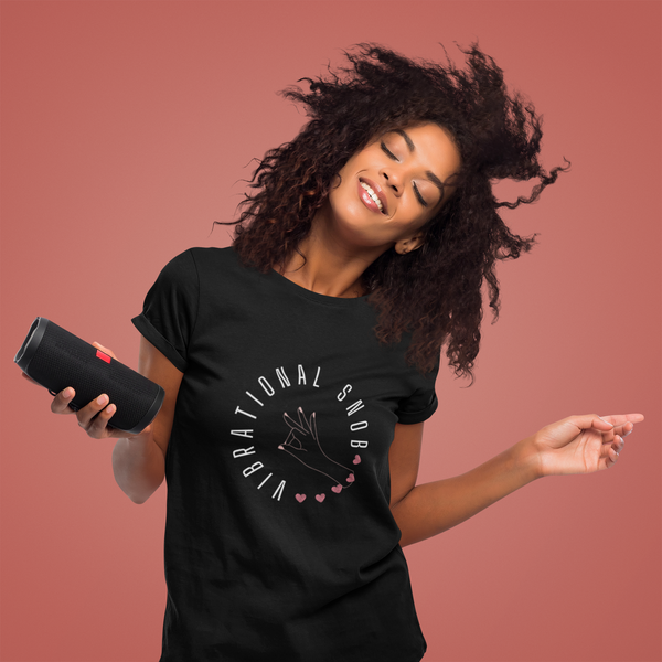 A woman enjoying some music and wearing a crew neck t-shirt in black with a design Vibrational Snob