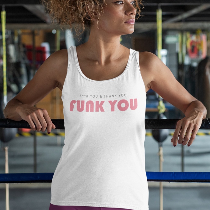A woman in a boxing gym wearing a white tank top with a quote pink Funk you 2020