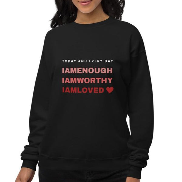 A woman at a studio  wearing crewneck sweatshirt in black with a quote I am enough, I am worthy, I am loved