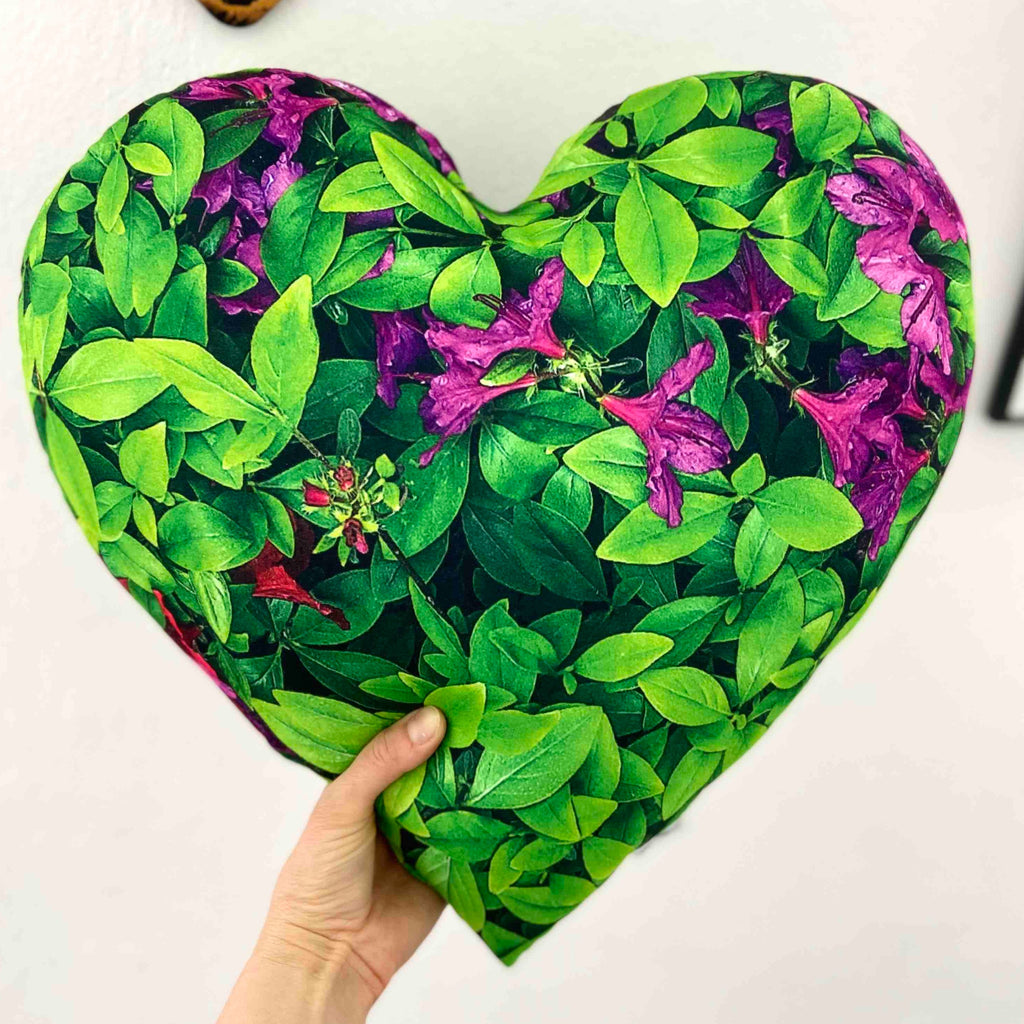 Heart shaped pillow in the jungle