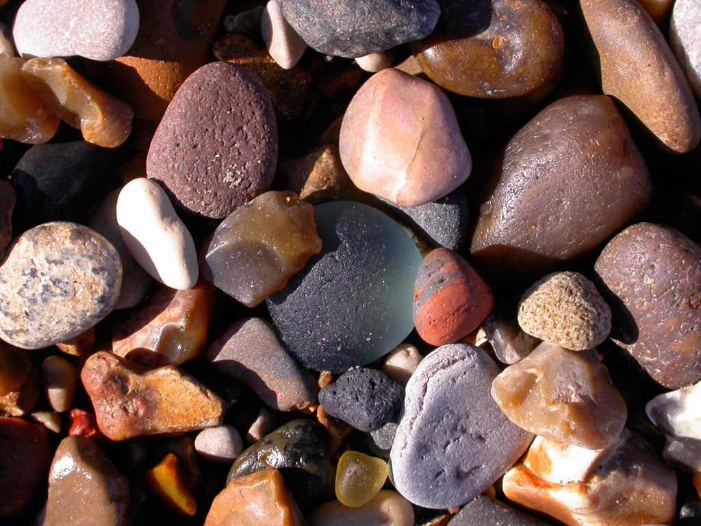 Sea glass and sea pebbles on a beach in Seaham, England.