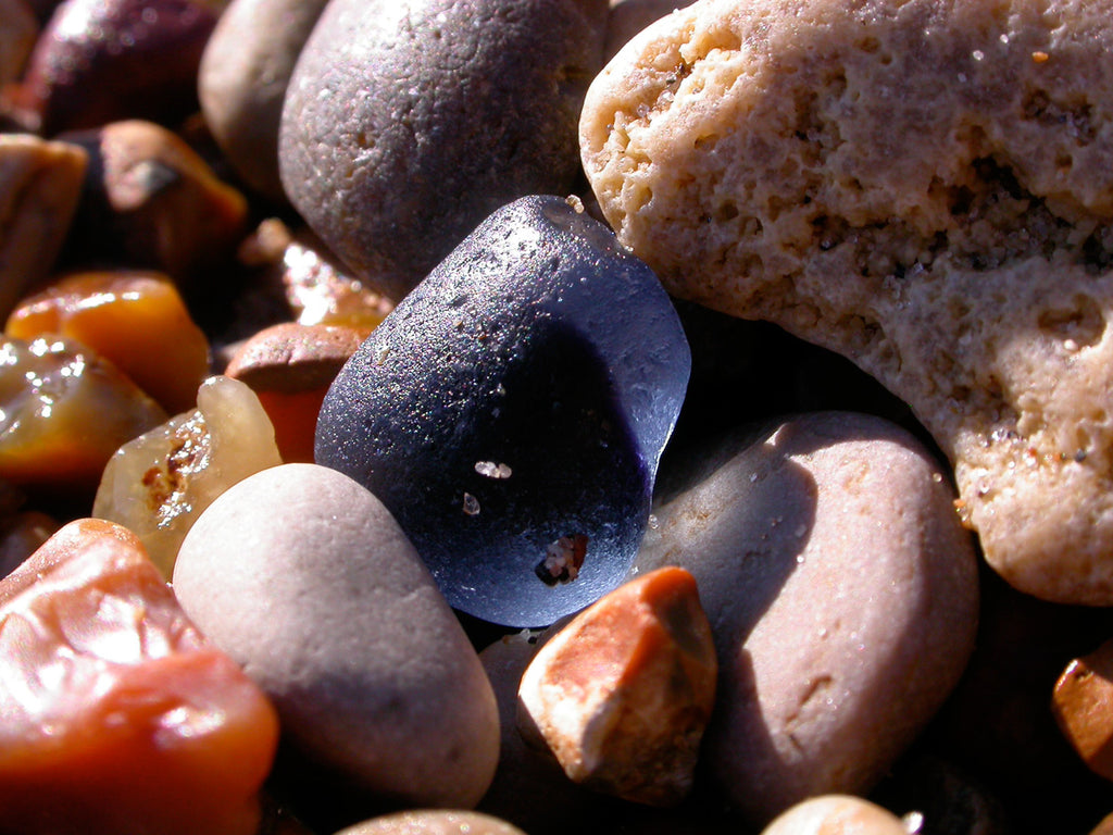 A beautiful pieces of multicolored in the sea pebble spread on a beach in Seaham, England which is near the site of a Victorian era glassworks.