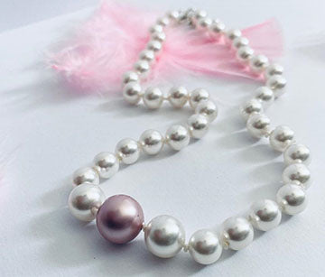 Swarovski white on pink pearl necklace