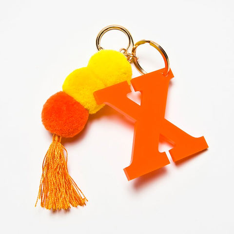 POM POM KEYCHAIN - ORANGE X
