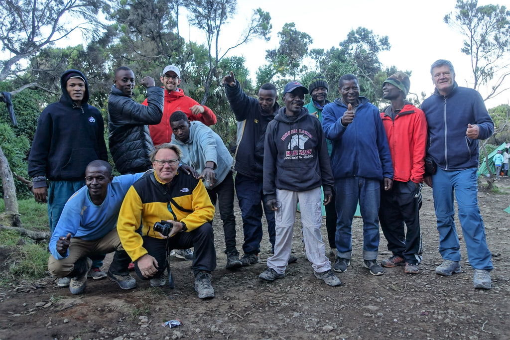 Porters and guides in a group photo on Mount Kilimanjaro