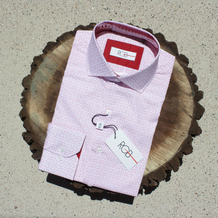 Red floral dress shirt on slice of walnut tree.
