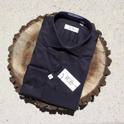 Black dress shirt on slice of walnut tree.