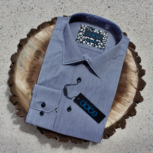 Men's grey and black striped dress shirt on slice of walnut tree.