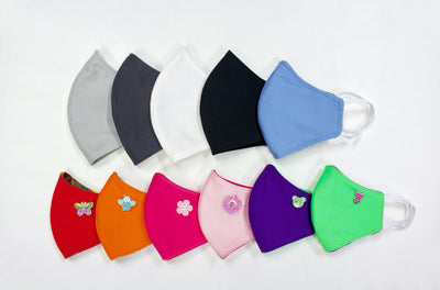 Various colors of cloth face masks displayed in two rows.