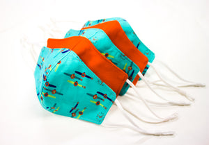 Kid's sea green, watch pattern and orange masks overlapping each other.