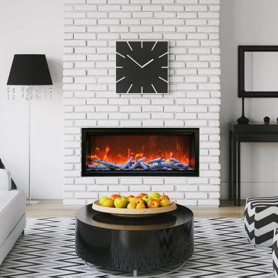 Amantii 88-Inch Extra Tall Clean Face Built-in Electric Fireplace in Black and White Interior Living Room.