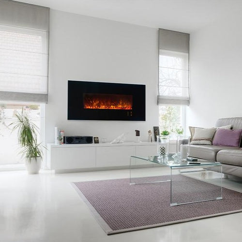 Built-In Electric Fireplace With Black Glass Front In A Living Room Interior With White Walls | Modern Flames 60-Inch Ambience CLX2 Wall Mount or Recessed Electric Fireplace