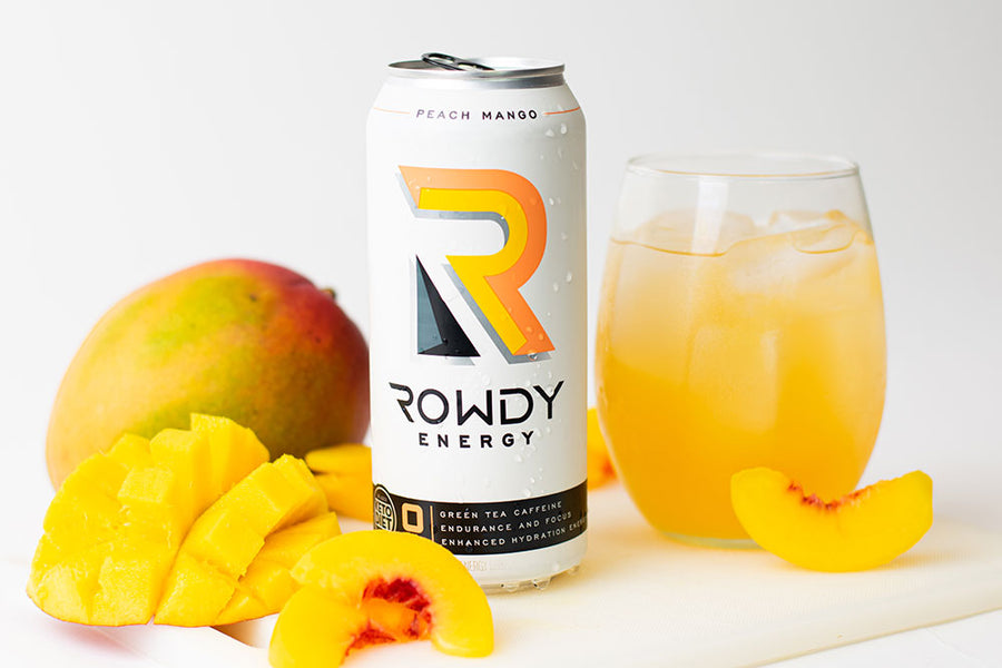 Rowdy Energy Drink Peach Mango 12-Pack, Sugar Free Energy Drink, 160 mg of Caffeine, Vitamins B6 and B12, Keto, Packed with Electrolytes for Enhanced Hydration.
