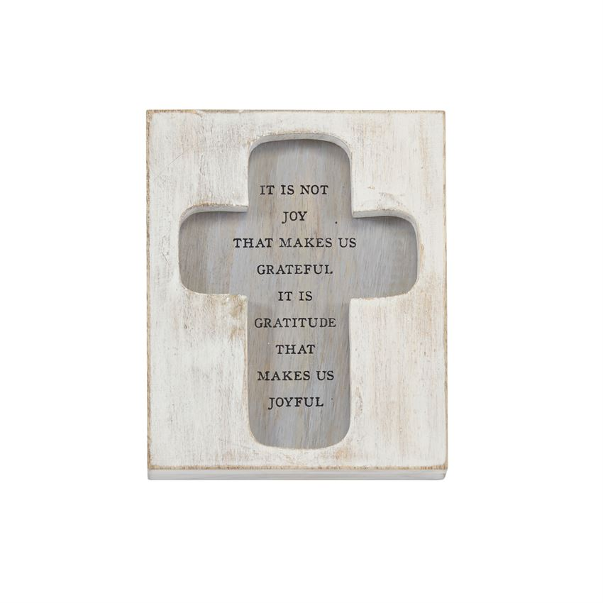A washed wood block plaque features a recessed cross with a printed