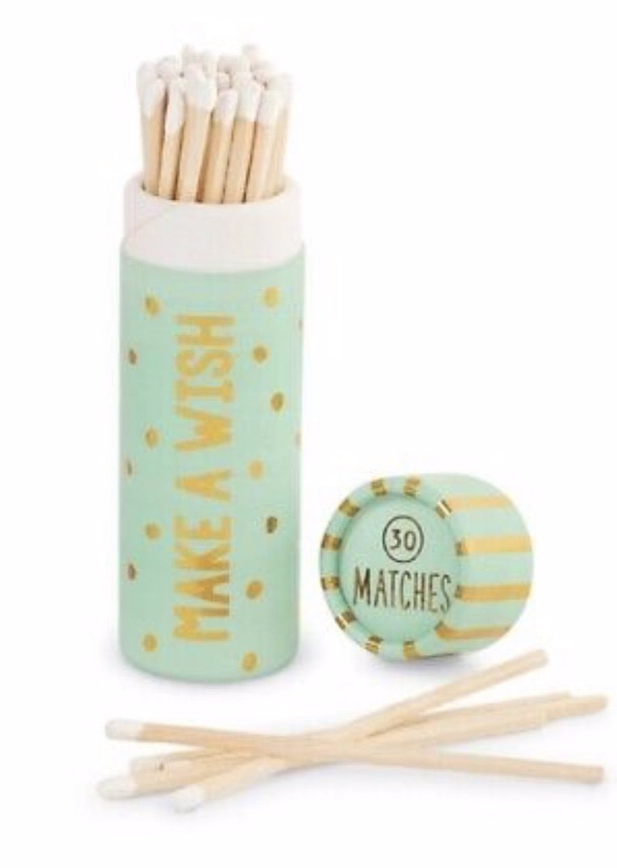 30 wooden matchsticks in a light pink and gold printed and foiled pattern paper tube. A cursive