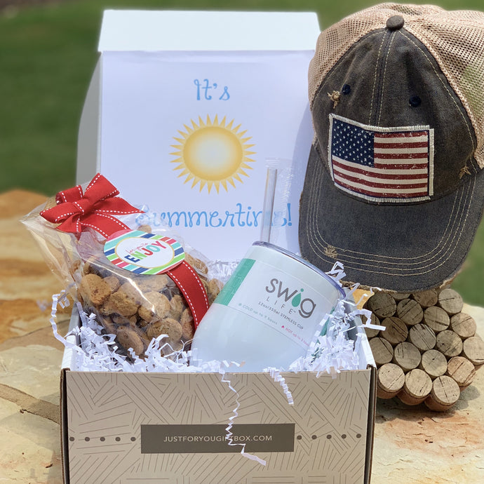 This Box Includes:  American Flag Vintage Hat (Choice Hat Style) Swig Diamond White Wine Cup- 16 oz. Oh Sugar Chocolate Chip Cookies 5 oz.