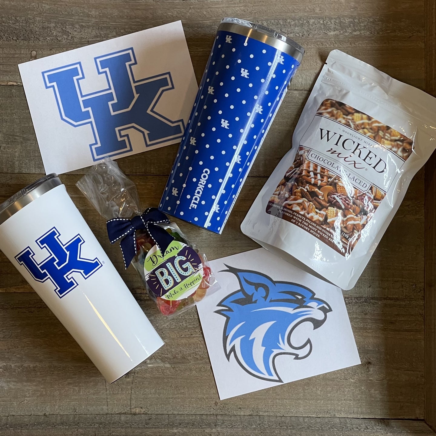 This Box Includes:  Corckcicle 24 oz. Tumbler With UK Logo or Polka Dot Oh Sugar 5 oz. Bag of Gummy Bears Wicked Mix (Original or Chocolate)