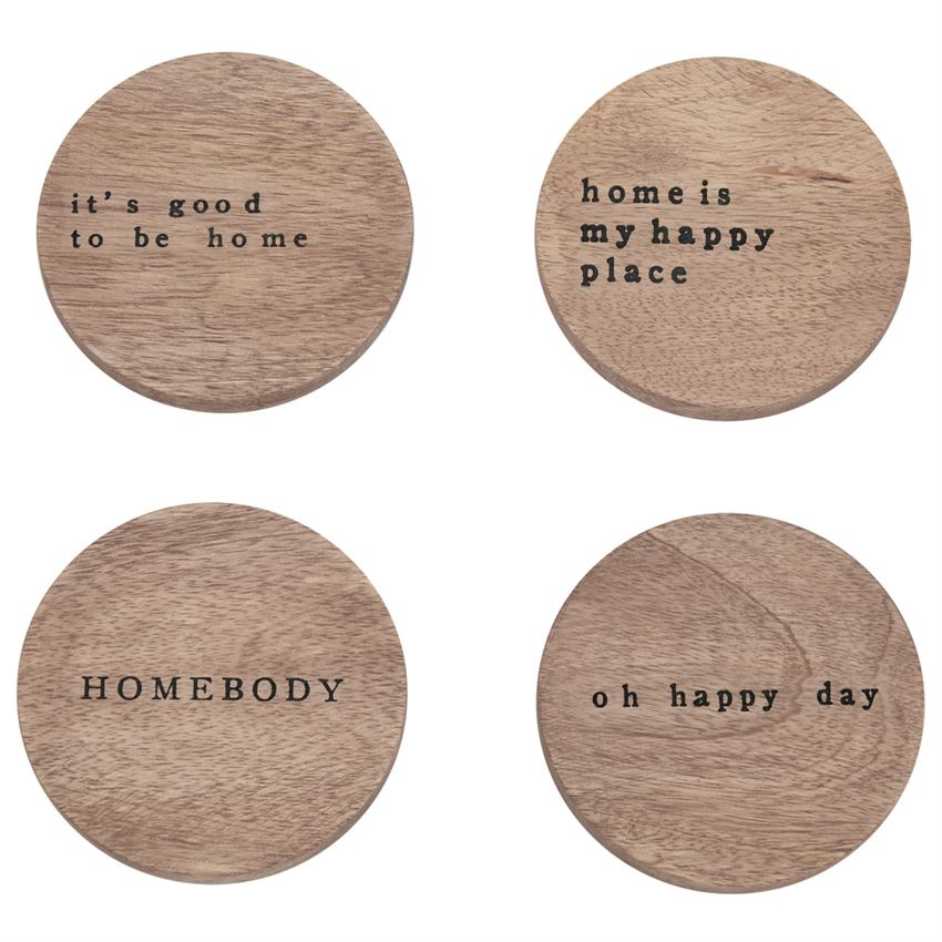 Set of four mango wood coasters feature printed sentiments. It's good to be home, home is my happy place, homebody, oh happy day. Arrive stacked and bound with twine.